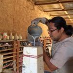 Ceramicist Omar Hernandez creating the bottles