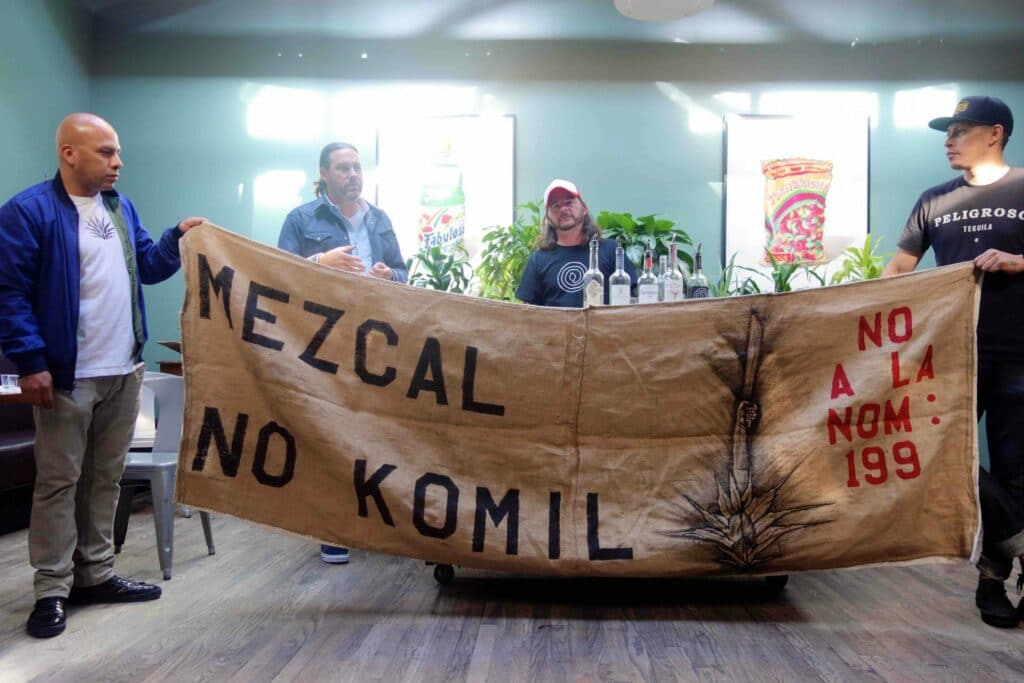 A protest banner against NOM 199 at the tasting. Photograph by Ferron Salniker
