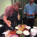 Dan Salls of Quiote putting the finising touches on his crowd pleasing Tacos al Pastor