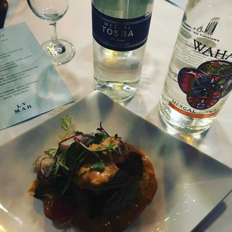 A shot from the LV Mar Mezcal Week dinner with mezcal pairings by Tosba and Wahaka.
