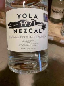The front label of a bottle of Yola Mezcal.